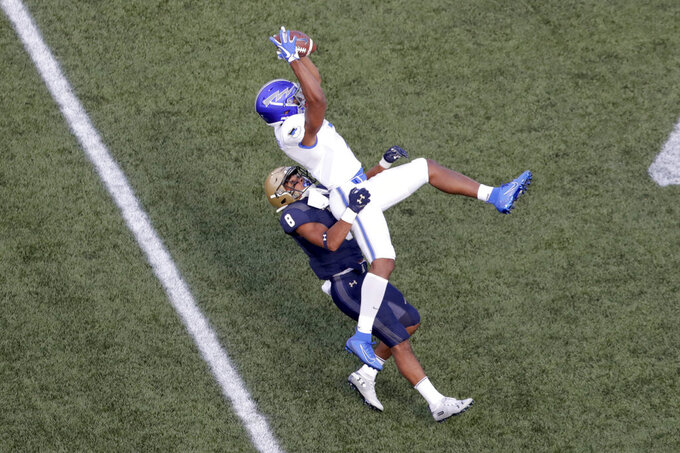 Air Force wide receiver Geraud Sanders, right, goes up to make a catch as Navy safety Elan Nash defends during the first half of an NCAA college football game Saturday, Oct. 5, 2019, in Annapolis, Md. (AP Photo/Julio Cortez)