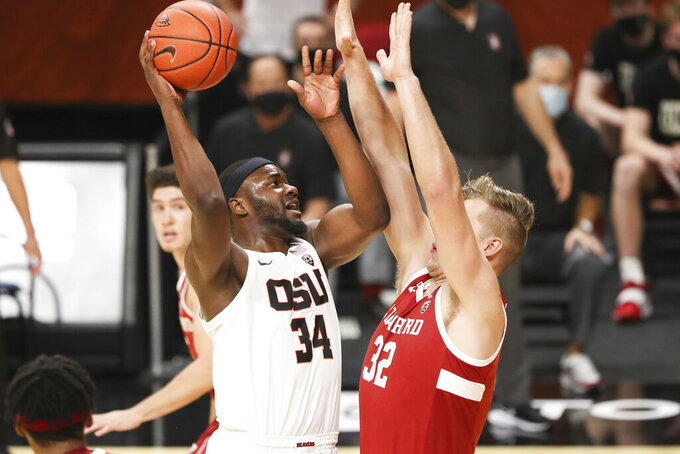 Oregon State's Rodrigue Andela (34) shoots over Stanford's Lukas Kisunas (32) during the first half of an NCAA college basketball game in Corvallis, Ore., Monday, Jan. 4, 2021. (AP Photo/Amanda Loman)