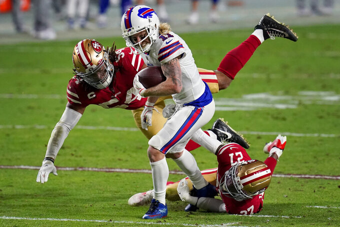 Buffalo Bills wide receiver Cole Beasley (11) eludes the tackles of San Francisco 49ers cornerback Dontae Johnson (27) and middle linebacker Fred Warner (54) during the first half of an NFL football game, Monday, Dec. 7, 2020, in Glendale, Ariz. (AP Photo/Ross D. Franklin)