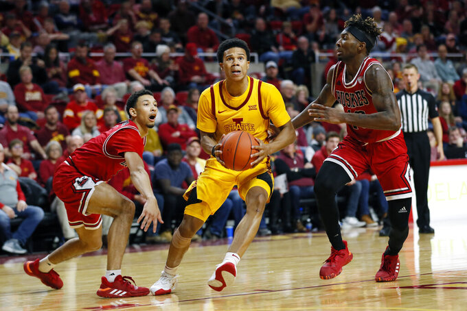 Iowa State guard Rasir Bolton, center, drives to the basket between Northern Illinois' Trendon Hankerson, left, and Eugene German, right, during the second half of an NCAA college basketball game, Tuesday, Nov. 12, 2019, in Ames, Iowa. Iowa State won 70-52. (AP Photo/Charlie Neibergall)