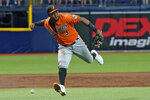 Baltimore Orioles third baseman Maikel Franco can't make the play on an infield single by Tampa Bay Rays' Manuel Margot during the first inning of a baseball game Saturday, June 12, 2021, in St. Petersburg, Fla. (AP Photo/Chris O'Meara)