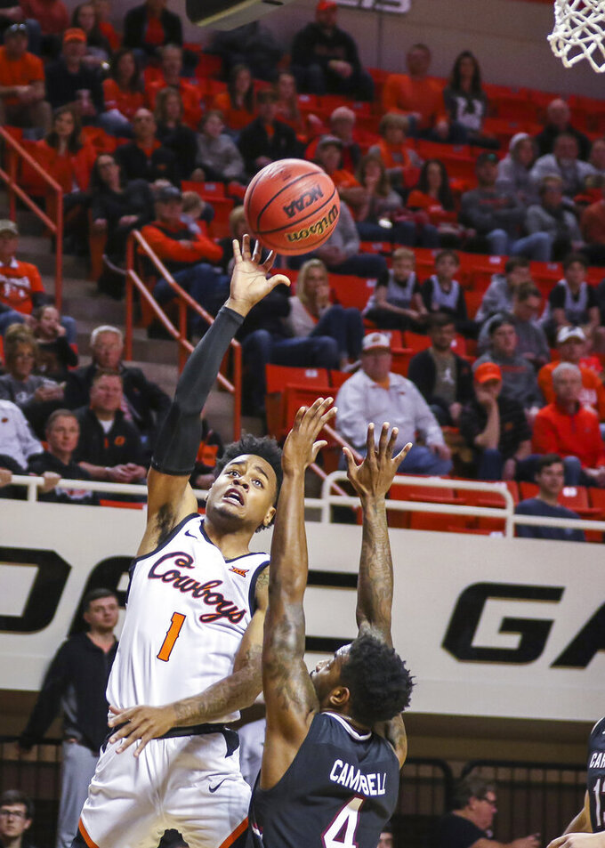 Oklahoma State's Curtis Jones makes a hook shot over South Carolina's Tre Campbell during an NCAA college basketball game, Saturday, Jan. 26, 2019, in Stillwater, Okla. (Devin Lawrence Wilber/Tulsa World via AP)