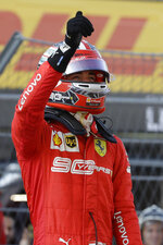 Ferrari driver Charles Leclerc of Monaco celebrates after setting the pole position at the end of the qualifying session practice at the 'Sochi Autodrom' Formula One circuit, in Sochi, Russia, Saturday, Sept.28, 2019. The Formula one race will be held on Sunday. (AP Photo/Luca Bruno)