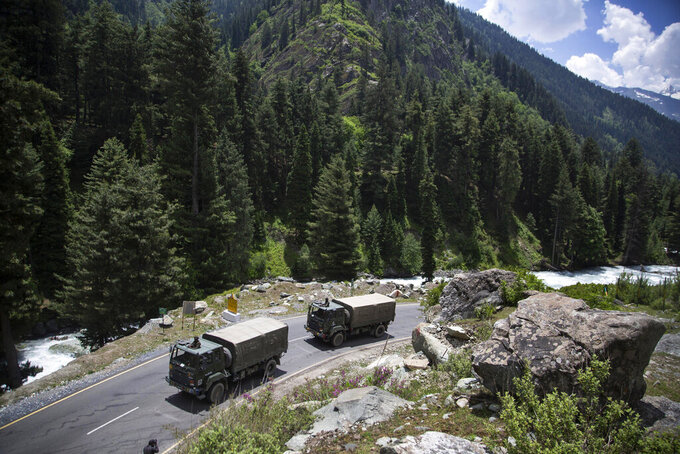 An Indian army convoy moves on the Srinagar- Ladakh highway at Gagangeer, north-east of Srinagar, India, Wednesday, June 17, 2020. Indian security forces said neither side fired any shots in the clash in the Ladakh region late Monday that was the first deadly confrontation on the disputed border between India and China since 1975. China said Wednesday that it is seeking a peaceful resolution to its Himalayan border dispute with India following the death of 20 Indian soldiers in the most violent confrontation in decades. (AP Photo/Mukhtar Khan)