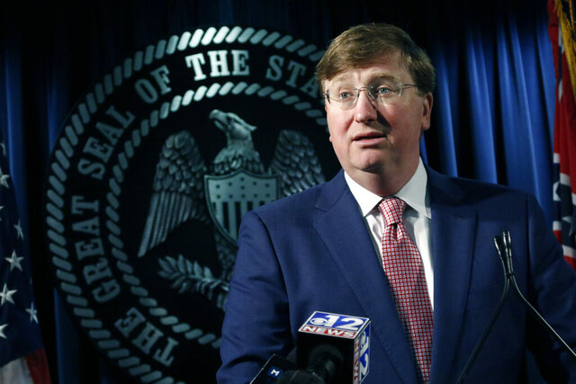 Republican Gov. Tate Reeves speaks with reporters about the state prison system, Thursday, Feb. 6, 2020, in Jackson, Miss. Reeves also gave an update on the search for a Mississippi Department of Corrections commissioner. (AP Photo/Rogelio V. Solis)