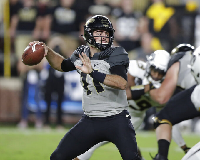 FILE - In this Saturday, Sept. 15, 2018, file photo, Purdue quarterback David Blough (11) throws against Missouri during the first half of an NCAA college football game, in West Lafayette, Ind.  Purdue coach Jeff Brohm has marveled at David Blough's resilience. During his first two seasons in West Lafayette, Brohm watched his quarterback rebound from frustrating performances, demoralizing injuries even the loss of his starting job. Blough's steady demeanor and inspirational words found a perfect home in the Boilermakers' locker room, serving as a model of how leaders respond in the face of adversity.  (AP Photo/Michael Conroy, File)