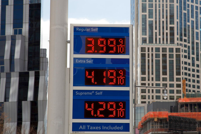 FILE- In this April 18, 2018, file photo, gas prices are displayed at a Mobil station in New York. President Donald Trump is declaring that oil prices are too high and blaming a coalition of countries that control a significant portion of the world's supply of crude petroleum. Trump tweeted on Wednesday: