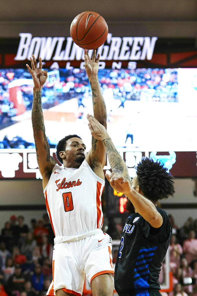 Bowling Green guard Michael Laster (0) shoots over Buffalo guard Jeremy Harris (2) in the second half of an NCAA college basketball game in Bowling Green, Ohio, Friday, Feb. 1, 2019. (AP Photo/Rick Osentoski)