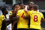 Watford's Craig Dawson (4), celebrates with teammates after scoring his side's opening goal during the English Premier League soccer match between Watford and Leicester City at the Vicarage Road Stadium in Watford, England, Saturday, June 20, 2020. (AP Photo/Alastair Grant, POOL)