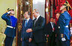 Russian President Vladimir Putin, right, and South Korean President Moon Jae-in walk together during their meeting at the Kremlin in Moscow, Russia, Friday, June 22, 2018. South Korean President is in Moscow on a state visit intended to boost bilateral economic ties.(Sergei Karpukhin/Pool Photo via AP)