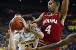 Michigan forward Brandon Johns Jr. (23) is defended by Indiana forward Trayce Jackson-Davis (4) during the second half of an NCAA college basketball game, Sunday, Feb. 16, 2020, in Ann Arbor, Mich. (AP Photo/Carlos Osorio)