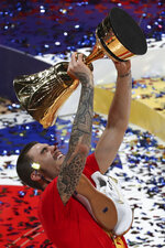 Spanish team players Juancho Hernangomez celebrates with winning trophy after the award ceremony for the FIBA Basketball World Cup Final, at the Cadillac Arena in Beijing, Sunday, Sept. 15, 2019. Spain has captured its second World Cup championship, defeating Argentina 95-75 on Sunday to give Marc Gasol a rare double-title year. (AP Photo/Ng Han Guan)