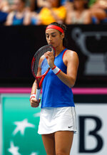 France's Caroline Garcia reacts as she plays Australia's Ashleigh Barty during their Fed Cup tennis final in Perth, Australia, Saturday, Nov. 9, 2019. (AP Photo/Trevor Collens)
