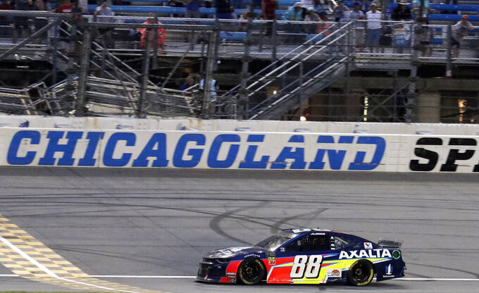 Alex Bowman drives to the finish line to win the NASCAR Cup Series auto race at Chicagoland Speedway in Joliet, Ill., Sunday, June 30, 2019. (AP Photo/Nam Y. Huh)