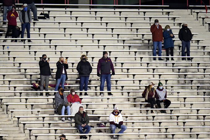 Minnesota fans are seen socially distanced during the first half of an NCAA college football game against Maryland, Friday, Oct. 30, 2020, in College Park, Md. (AP Photo/Julio Cortez)