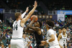 Hawaii forward Zigmars Raimo (14) and guard Drew Buggs defend against Washington guard Nahziah Carter (11) during the first half of an NCAA college basketball game Monday, Dec. 23, 2019, in Honolulu. (AP Photo/Marco Garcia)