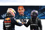 Winner Mercedes driver Lewis Hamilton of Britain, right, shakes hands with second placed Red Bull driver Max Verstappen of the Netherlands after the Portugal Formula One Grand Prix at the Algarve International Circuit near Portimao, Portugal, Sunday, May 2, 2021. (Gabriel Bouys/Pool via AP)