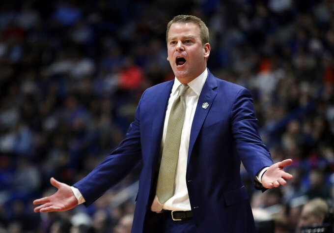 Marquette head coach Steve Wojciechowski complains to the referee during the first half of a first round men's college basketball game against Murray State in the NCAA Tournament, Thursday, March 21, 2019, in Hartford, Conn. (AP Photo/Elise Amendola)