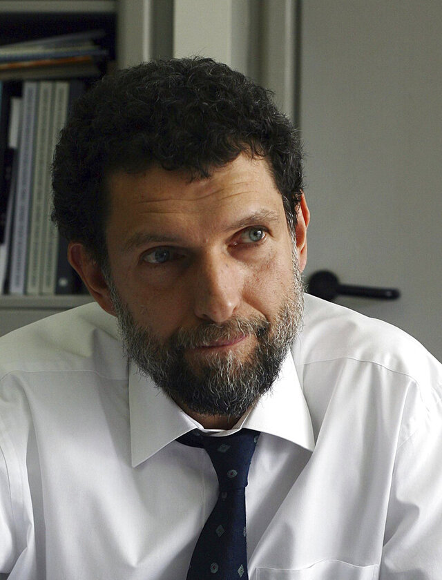 FILE - In this April 29, 2015 file photo, Osman Kavala, a Turkish philanthropist businessman and human rights defender is photographed, in Istanbul. Kavala rejected accusations of espionage and attempting to overthrow the government in connection to a failed coup four years ago, telling a court on Friday, Dec. 18, 2020 that he opposes all efforts to takeover power by force. Osman Kavala addressed the court from his prison in the outskirts of Istanbul through a judicial video conference system in the opening hearing of a new trial against him, which human rights groups have denounced as unjust and politically-motivated. (AP Photo, File)