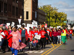 Thousands of Chicago Teachers Union members and their supporters march through the Near West Side after a rally in Union Park on day five of a Chicago Public Schools district-wide strike, Monday afternoon, Oct. 21, 2019. (Ashlee Rezin Garcia/Chicago Sun-Times via AP)