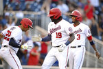 Washington Nationals' Josh Bell celebrates his three-run home run with Juan Soto (22) and Alcides Escobar (3) during the seventh inning of a baseball game against the Toronto Blue Jays, Wednesday, Aug. 18, 2021, in Washington. The Nationals won 8-5. (AP Photo/Nick Wass)