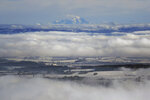 Mont Blanc is seen behind the snowy plains around Lyon, central France, Friday, Nov. 15, 2019. A dump of heavy snow in southern France has brought down power lines and trees, killing one person, and caused widespread traffic disruption. (AP Photo/Laurent Cipriani)