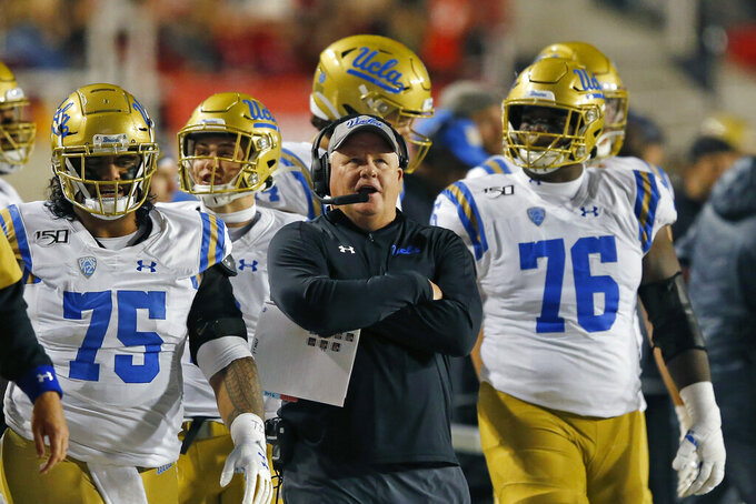 FILE - In this Saturday, Nov. 16, 2019 file photo, UCLA head coach Chip Kelly looks on in the second half during an NCAA college football game against Utah in Salt Lake City. Chip Kelly was supposed to lead a UCLA resurgence when he arrived in 2017, but the Bruins have gone 10-21 in three seasons. Year 4 could be the start of the turnaround.(AP Photo/Rick Bowmer, File)