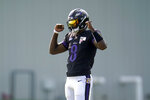 FILE - Baltimore Ravens quarterback Lamar Jackson reacts after running a drill during an NFL football training camp practice, Tuesday, Aug. 25, 2020, in Owings Mills, Md. The Ravens play at the Cleveland Browns on Sunday, Sept. 13, 2020.(AP Photo/Julio Cortez, File)