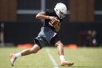 Tennessee quarterback JT Shrout participates in a drill during the first NCAA college football practice of the season in Knoxville, Tenn., Friday, Aug. 3, 2018. (Caitie McMekin/Knoxville News Sentinel via AP)