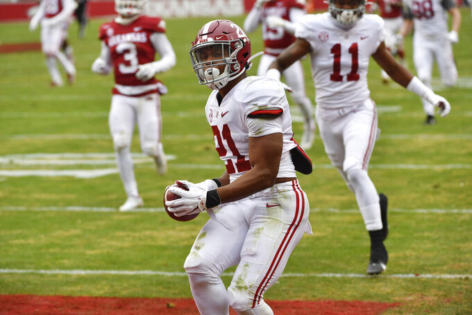 Alabama running back Jase McClellan (21) scores a touchdown on an 80-yard run against Arkansas during the second half of an NCAA college football game Saturday, Dec. 12, 2020, in Fayetteville, Ark. (AP Photo/Michael Woods)
