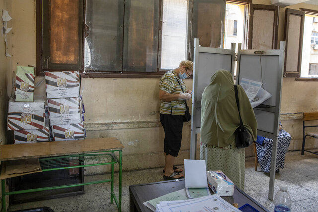 Women vote on the first day of the Senate elections inside a polling station in Cairo, Egypt, Tuesday, Aug. 11, 2020. Egyptians started voting on Tuesday for the Senate, the upper chamber of parliament that was revived as part of constitutional amendments approved in a referendum last year — an election that comes as the country faces an uptick in daily numbers of new coronavirus cases. (AP Photo/Nariman El-Mofty)