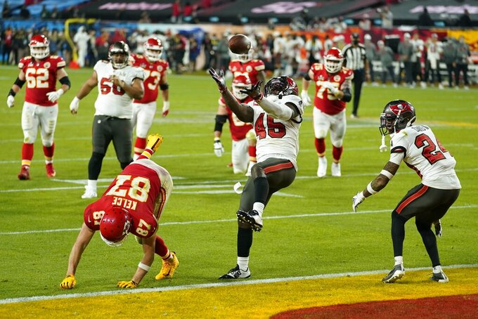 Tampa Bay Buccaneers inside linebacker Devin White makes an interception against Kansas City Chiefs tight end Travis Kelce during the second half of the NFL Super Bowl 55 football game Sunday, Feb. 7, 2021, in Tampa, Fla. (AP Photo/Mark Humphrey)