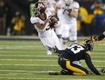 Minnesota wide receiver Rashod Bateman, left, is tripped by Iowa defensive back Riley Moss while running the ball during the second half of an NCAA college football game, Saturday, Nov. 16, 2019, in Iowa City, Iowa. (AP Photo/Matthew Putney)