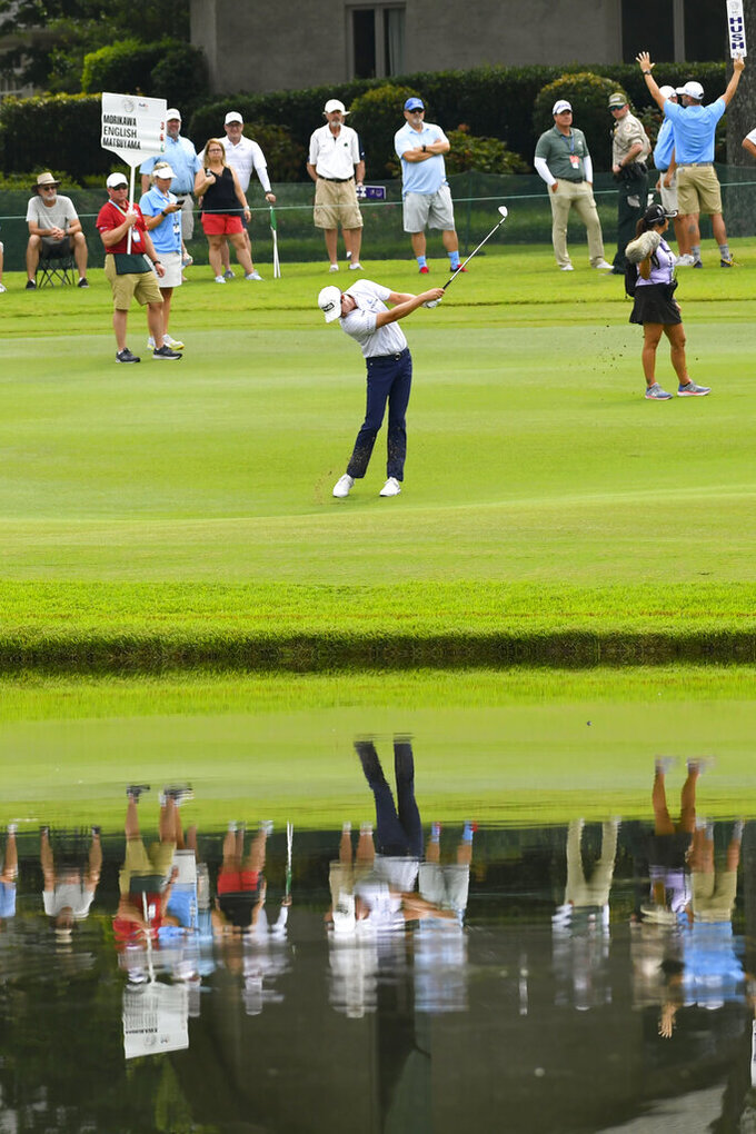 Harris English hits on the 12th hole during the second round in the World Golf Championship-FedEx St. Jude Invitational tournament, Friday, Aug. 6, 2021, in Memphis, Tenn. (AP Photo/John Amis)