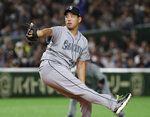 Seattle Mariners starter Yusei Kikuchi pitches against the Oakland Athletics in the first inning of Game 2 of their Major League baseball opening series at Tokyo Dome in Tokyo, Thursday, March 21, 2019. (AP Photo/Koji Sasahara)
