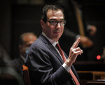 Treasury Secretary Stephen Mnuchin, gestures toward Federal Reserve Board Chairman Jerome Powell, as they appear before a House Committee on Financial Services hearing on oversight of the Treasury Department and Federal Reserve pandemic response, Tuesday, June 30, 2020 on Capitol Hill in Washington.  (Bill O'Leary/The Washington Post via AP, Pool)