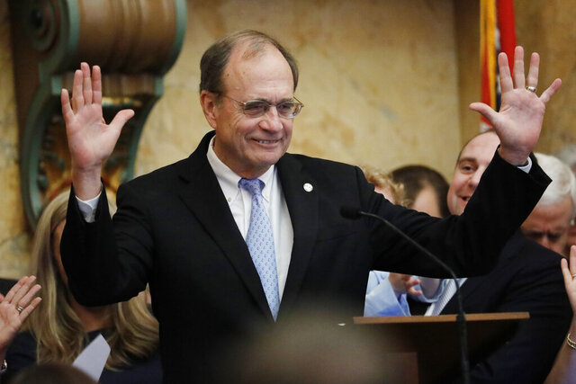 Lt. Gov. Delbert Hosemann, reacts to the lawmakers applause after addressing the joint session of the Legislature in House chambers at the Mississippi Capitol in Jackson, Miss., following the swearing in of all the statewide elected officials except the governor, Thursday, Jan. 9, 2020. Gov.-elect Tate Reeves will be inaugurated Tuesday, Jan. 14. (AP Photo/Rogelio V. Solis)