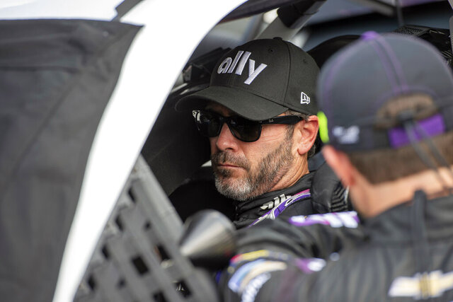 FILE - In this Aug. 23, 2020, file photo, Jimmie Johnson (48) sits in his car before the start of a NASCAR Cup Series auto race at Dover International Speedway in Dover, Del. Johnson is retiring from full-time NASCAR competition in Sunday's season finale at Phoenix Raceway, leaving the sport as a seven-time champion ranked sixth on the all-time wins list with 83 career victories. (AP Photo/Jason Minto, File)