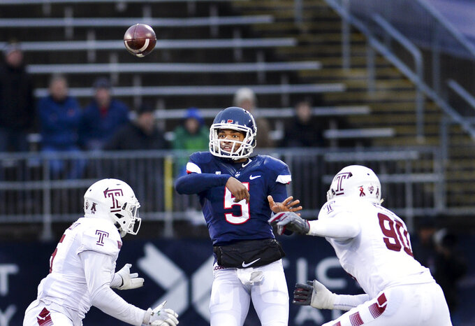 Connecticut quarterback David Pindell (5) gets a pass off in the first half of an NCAA college football game against Temple, Saturday, Nov. 24, 2018, in East Hartford, Conn. (AP Photo/Stephen Dunn)