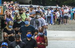 Voters wait in line before voting at the Park Tavern polling place in Atlanta on Tuesday, June 9, 2020. (John Spink/Atlanta Journal-Constitution via AP)