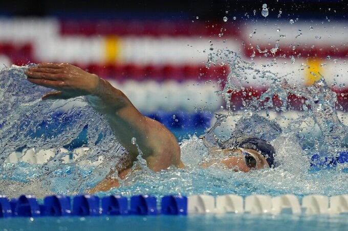 Jake Mitchell participates in a lone men's 400 freestyle qualifying heat during wave 2 of the U.S. Olympic Swim Trials on Tuesday, June 15, 2021, in Omaha, Neb. (AP Photo/Jeff Roberson)