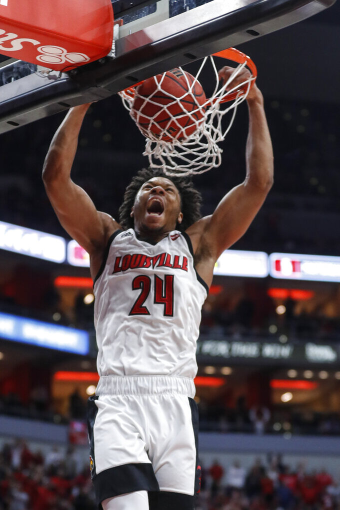 Louisville forward Dwayne Sutton dunks the ball during the second half of the team's NCAA college basketball game against Wake Forest on Wednesday, Feb. 5, 2020, in Louisville, Ky. Louisville won 86-76. (AP Photo/Wade Payne)