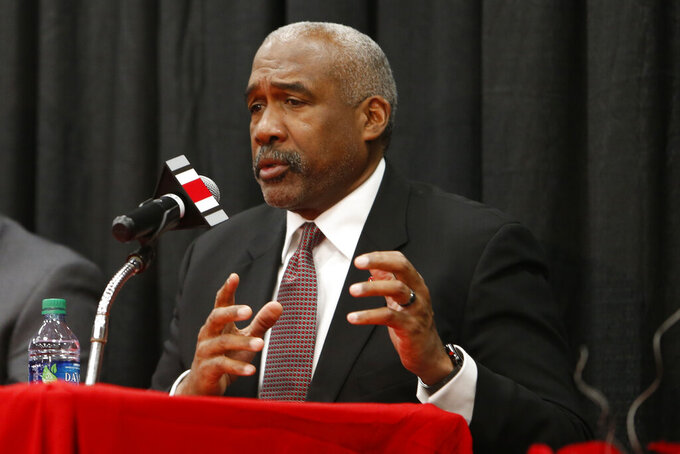 FILE - In this Dec. 4, 2018, file photo, Ohio State athletics director Gene Smith answers questions during a news conference in Columbus, Ohio. Ohio State athletic director Gene Smith said the discussion is just beginning on prepare-to-play issues after most programs had spring football practice shortened or wiped out and had to deal with all of their spring sports being called to a halt. (AP Photo/Jay LaPrete, File)