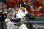 Houston Astros relief pitcher Joe Smith throws against the Washington Nationals during the eighth inning of Game 3 of the baseball World Series Friday, Oct. 25, 2019, in Washington. (AP Photo/Patrick Semansky)