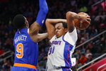Detroit Pistons forward John Henson (31) looks to pass as New York Knicks guard RJ Barrett (9) defends during the second half of an NBA basketball game, Saturday, Feb. 8, 2020, in Detroit. (AP Photo/Carlos Osorio)