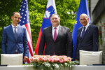 Slovenia's Foreign Minister Anze Logar, left, US Secretary of State Mike Pompeo, center, and Slovenia's Prime Minister Janez Jansa pose for the media after signing an agreement on fifth-generation internet technology in Bled, Slovenia, Thursday, Aug. 13, 2020. Pompeo is on a five-day visit to central Europe with a hefty agenda including China's role in 5G network construction. (Jure Makovec/Pool Photo via AP)