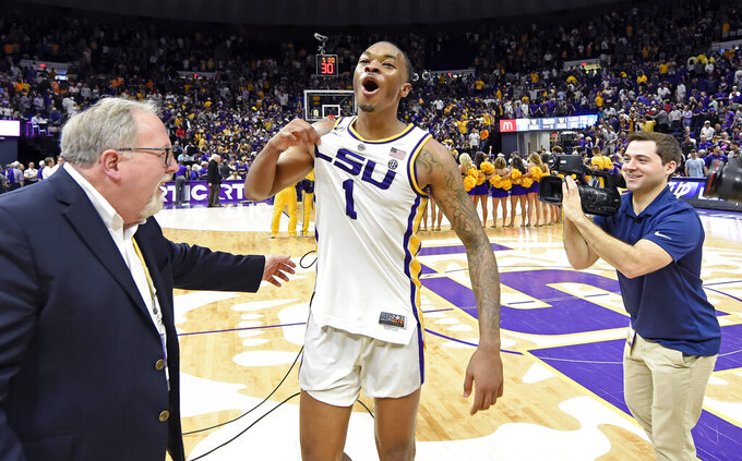 LSU guard Ja'vonte Smart (1) celebrates their overtime win in an NCAA college basketball game against Tennsessee, Saturday, Feb. 23, 2019, in Baton Rouge, La. (AP Photo/Bill Feig)