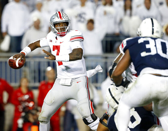 FILE - In this Saturday, Sept. 29, 2018 file photo, Ohio State quarterback Dwayne Haskins Jr. (7) throws a pass against Penn State during the second half of an NCAA college football game in State College, Pa. Last year's Ohio State hero has to try to beat Michigan again in The Game. Backup quarterback Dwayne Haskins Jr. entered the game in the third quarter because an injury to starter J.T. Barrett. Haskins sparked a touchdown drive and an eventual 31-20 win over the Wolverines in Ann Arbor. Now the starter, Haskins will lead the No. 10 Buckeyes against No. 4 Michigan on Saturday at Ohio Stadium. Ohio State enters the game in an unfamiliar position _ underdog. (AP Photo/Chris Knight, File)