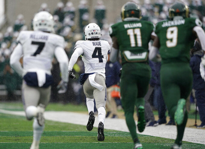 Utah State safety Aaron Wade (4) runs an interception back for a touchdown against Colorado State during the first half of an NCAA football game Saturday, Nov. 17, 2018, in Fort Collins, Colo. (AP Photo/Jack Dempsey)