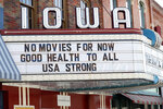 The marquee for the Iowa Theater, closed in response to the coronavirus outbreak, is seen on John Wayne Drive, Wednesday, April 1, 2020, in Winterset, Iowa. The new coronavirus causes mild or moderate symptoms for most people, but for some, especially older adults and people with existing health problems, it can cause more severe illness or death. (AP Photo/Charlie Neibergall)
